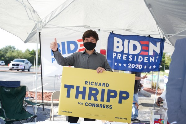 Thripp with Sign and Biden Flags