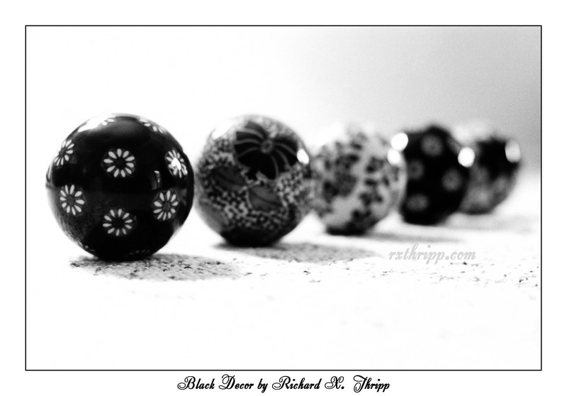 Black Decor — shiny black ornaments in a line