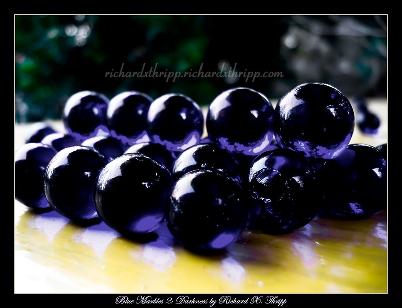 Blue Marbles 2: Darkness — stacks of marbles, with a touch of purple and black