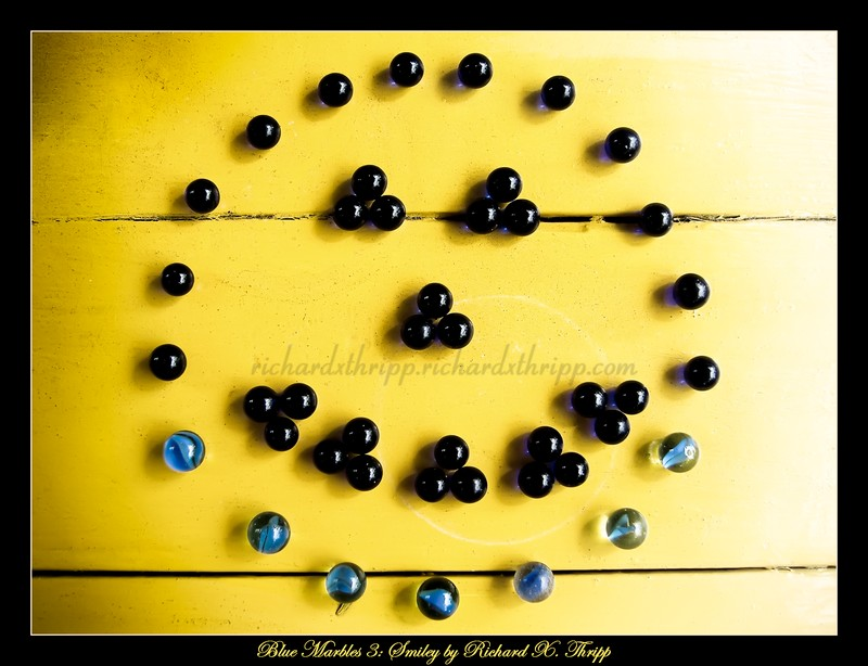 Blue Marbles 3: Smiley — marble art: a smiling face