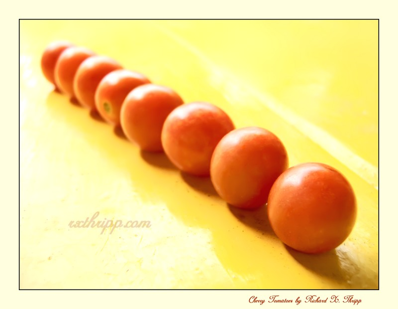 Cherry Tomatoes — eight bite-sized tomatoes in a row