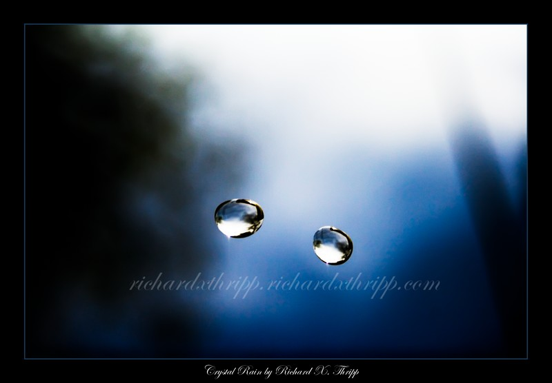 Crystal Rain — two blue raindrops suspended in the air