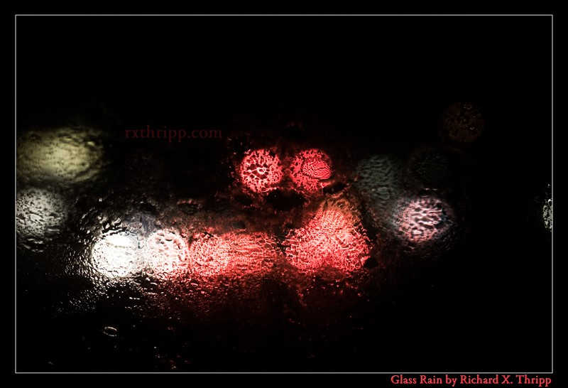 Glass Rain — torrential rain on the windshield at night, with stop lights