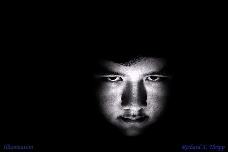 Illumination — a scary face lit up on black