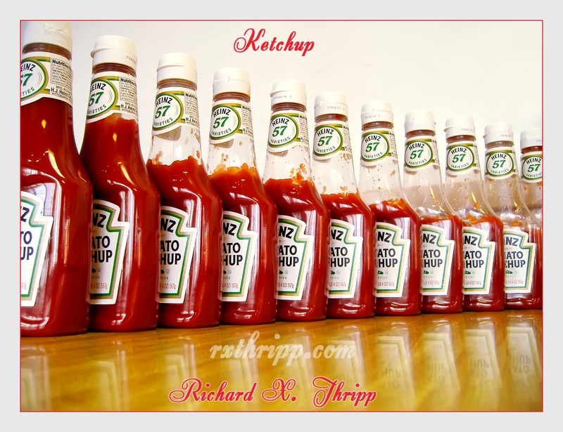 Ketchup — 11 bottles of Heinz ketchup in a line