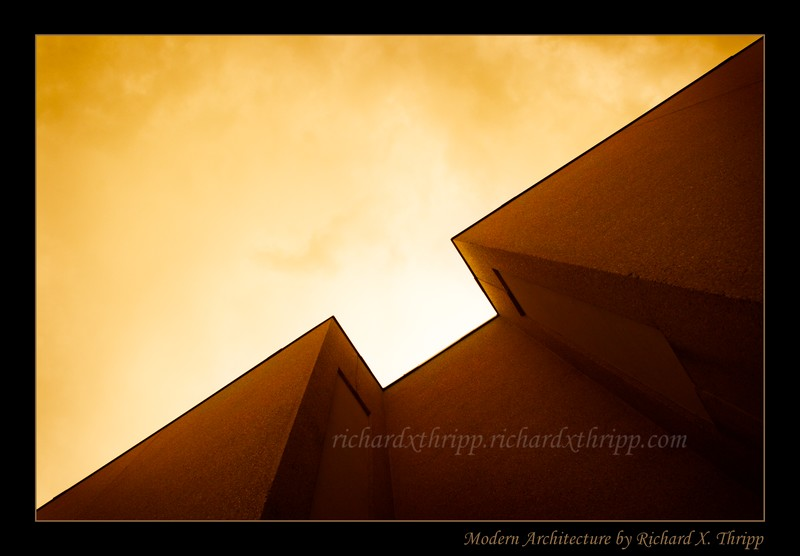 Modern Architecture — a diagonal of a building against an orange sky