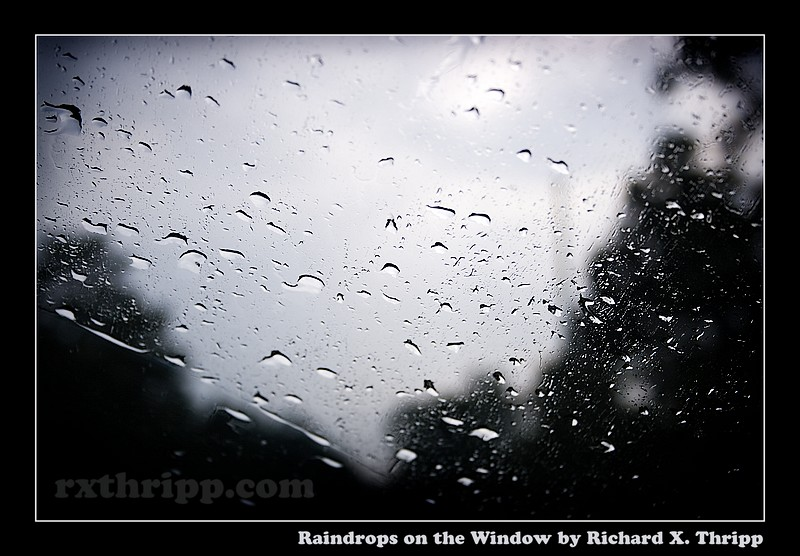 Raindrops on the Window — droplets against the clouds and sky
