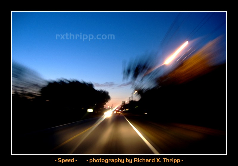 Speed — speeding down a city road at night