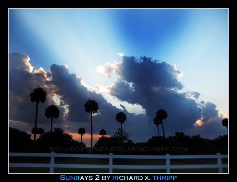Sunrays 2 — blue beams of sunshine pierce the clouds