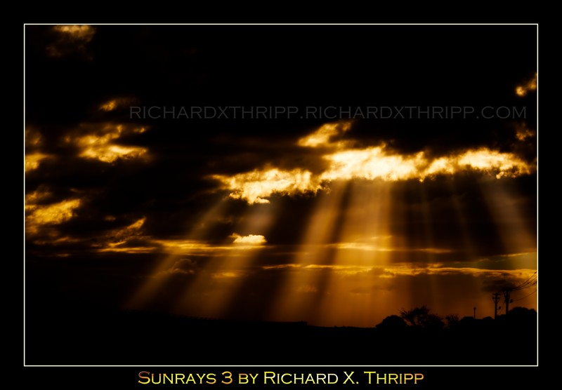Sunrays 3 — orange rays of sunshine pierce black clouds