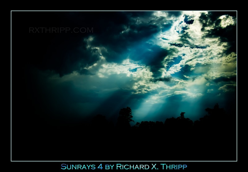 Sunrays 4 — deep blue sunrays break through the clouds