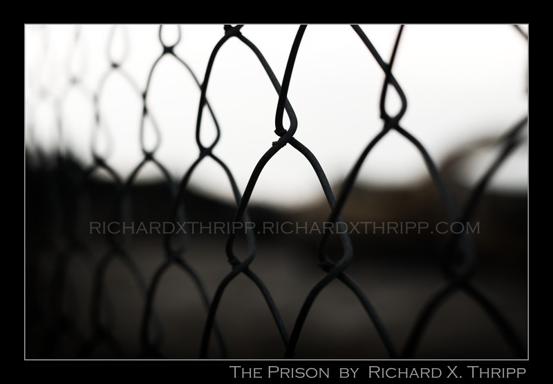 The Prison — the evil chain link fence